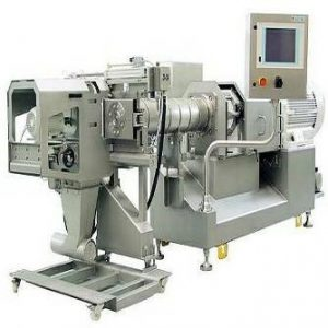 Figure 1. A twin-screw extruder with the die cutter set up (with permission from Buhler, Inc.)